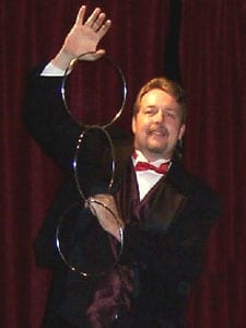 Hire a close-up magician for your party or corporate event. $200 for 90 magical minutes.